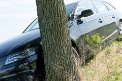 Black Car Accident hit the tree. On the road royalty free stock image