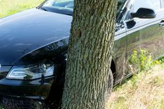 Black Car Accident hit the tree. On the road stock photography