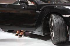 Black Car And Women S Legs Stock Photo
