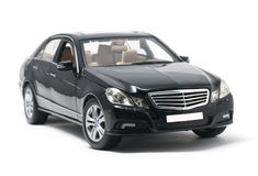 Black car. Beautiful black car close-up on white background Royalty Free Stock Photography