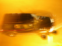 Black car in blur motion. Fast car at night with motion Royalty Free Stock Photography