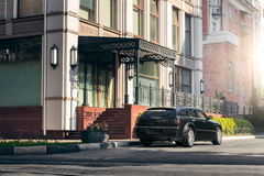 Black car Chrysler 300c standing on asphalt road in the city at daytime. Saratov, Russia - August 9, 2015: Black car Chrysler 300c standing on asphalt road in Stock Image