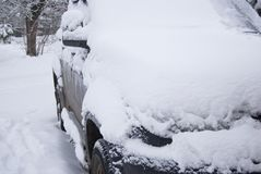 The black car is completely covered with snow. Consequences of heavy snowfall Royalty Free Stock Photo