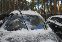 Black car covered with snow and ice. Stock Images