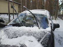 Black car covered with snow and ice. Stock Photography