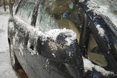 Black car covered with snow and ice. Winter Royalty Free Stock Photo