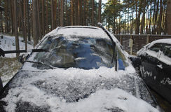 Black car covered with snow and ice. Winter Stock Images