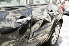 Black car with dent Royalty Free Stock Images