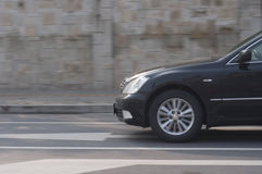 A black car driving Royalty Free Stock Photo