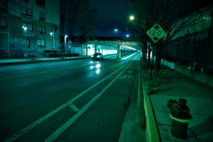 A black car driving through a dark Chicago city tunnel. Stock Images