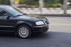 A black car driving. Royalty Free Stock Images
