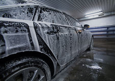 Black car in foam on sink Royalty Free Stock Photos