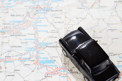 Black car on a german road map. Black toy car on a german road map Stock Photography