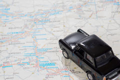Black car on a german road map. Black toy car on a german road map Stock Photos