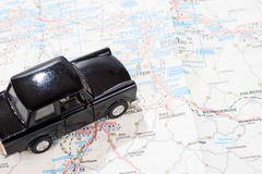 Black car on a german road map Stock Images