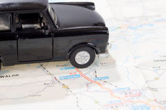 Black car on a german road map Stock Photo
