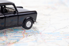 Black car on a german road map Royalty Free Stock Photos