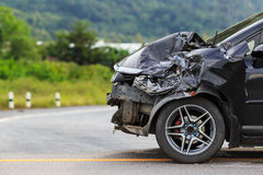 Black car get damaged by accident on the road. Front of black car get damaged by accident on the road Stock Images