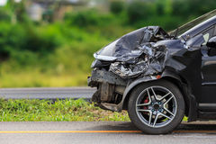 Black car get damaged by accident on the road. Front of black car get damaged by accident on the road Royalty Free Stock Image