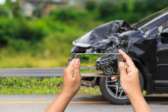 Black car get damaged by accident on the road. Front of black car get damaged by accident on the road Royalty Free Stock Photos