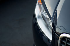 Black car grille and headlamp Royalty Free Stock Photo