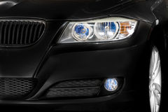 Black car headlights and rim details Royalty Free Stock Image
