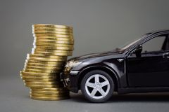 Black car hit pile of coins. Road traffic accident, car insurance concept. black car hit pile of coins royalty free stock photo