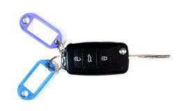 Black car key with color tags. Close up car ignition key isolated on white background. Black car key with color labels. Free space for text on white labels on Stock Photography
