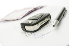 Car key on a contract of car sale Stock Photo