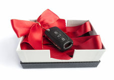 Black car key in a present box Royalty Free Stock Image
