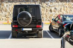 Black car Mercedes-Benz G63 AMG on an outdoor parking lot on a sunny day, back view. stock photos