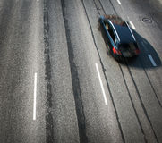 Black car moving on old highway road Royalty Free Stock Images