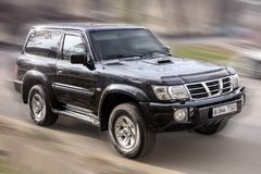 Black car Nissan. Black Nissan off-road car on a blurry background Stock Photography