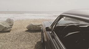Black Car Parked on the Seashore Stock Images