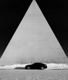Black car and a pyramid Royalty Free Stock Photo