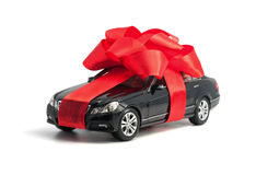 Black car with red bow Royalty Free Stock Photo