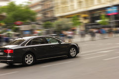 Black car on road Royalty Free Stock Photography
