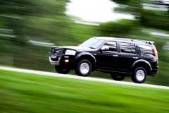 Black car rushing away Royalty Free Stock Image