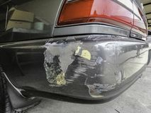 Black car is scratched and damaged after car accident stock photos