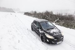 Car on a snow covered road Royalty Free Stock Images