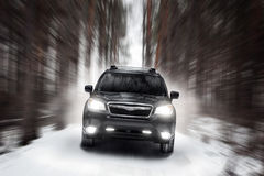 Black car speed drive on off road at winter daytime Stock Photo