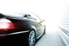 Black car speeding Royalty Free Stock Photo