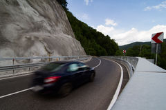 Black car on steep mountain road Royalty Free Stock Images