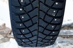 Black car tire with pattern and spikes. Close up Royalty Free Stock Photo
