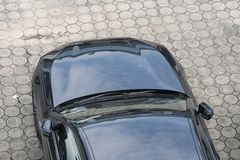 Black car Top view of parking lane. Black car from above in the parking area of a top view of the house royalty free stock photo