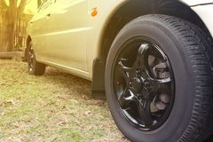 Black car wheel in retro style. Background Royalty Free Stock Photography
