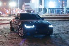 Black car at winter night Royalty Free Stock Photography