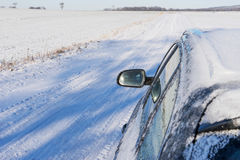 Black car on winter road. With snow Stock Photography