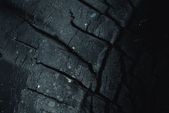 Black carbon charcoal dry crack old tire. Stock Photos