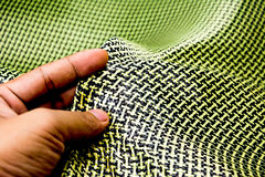 Black carbon fiber composite raw material close up background. Kevlar aramid Stock Images